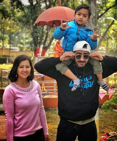Girish with his wife and son