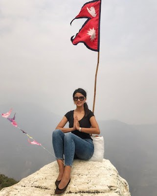 Sipora Gurung with national flag of Nepal