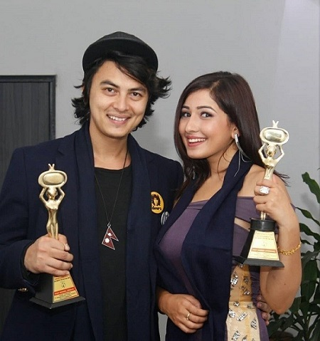 paul shah and Aanchal Sharma with their award